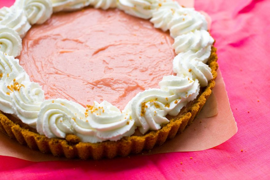 This pudding tart with a graham cracker crust is made with the pureed flesh of watermelon. Serve this summertime treat with plenty of whipped cream. (Associated Press)