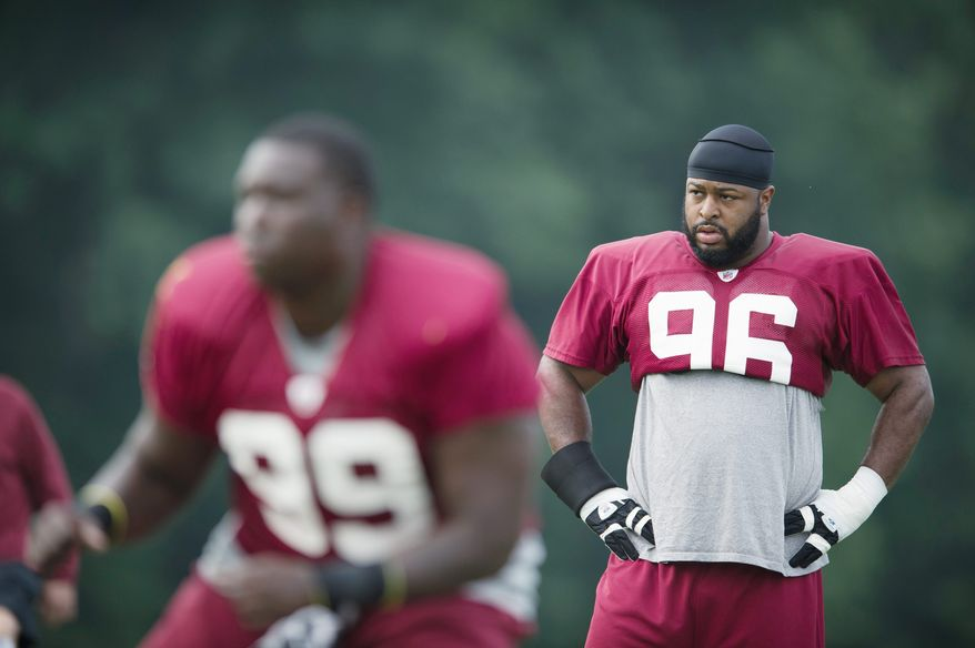 Washington Redskins defensive lineman Barry Cofield (96) and defensive end Jarvis Jenkins (99) work through drills during training camp at Redskins Park in Ashburn, Va, Tuesday, August 9, 2011. (Rod Lamkey Jr./The Washington Times)