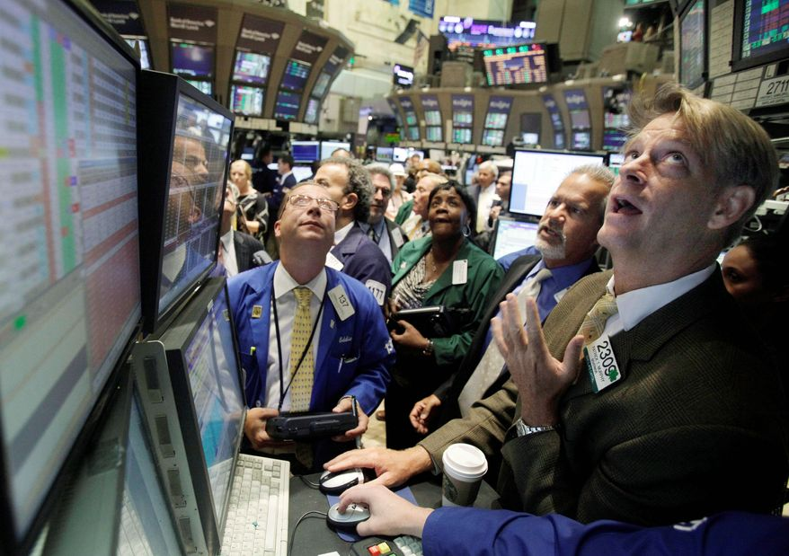 A favorable report on jobless claims was a bit of good news in a gloomy economic picture that led to gains on Wall Street on Thursday. The Dow, Standard & Poor's and Nasdaq all closed in positive territory. (Associated Press)