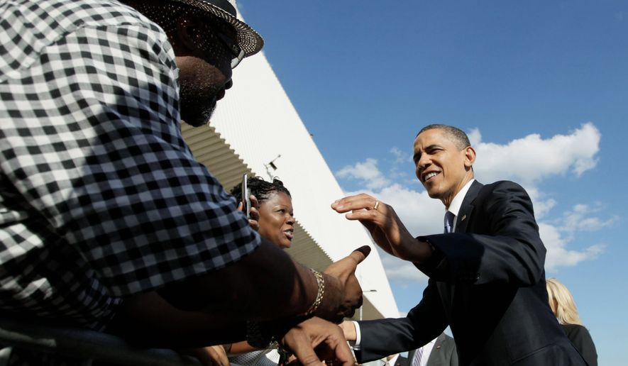 President Obama shakes hands on the tarmac at John F. Kennedy International Airport Thursday on his way to fundraisers in New York. (Associated Press)