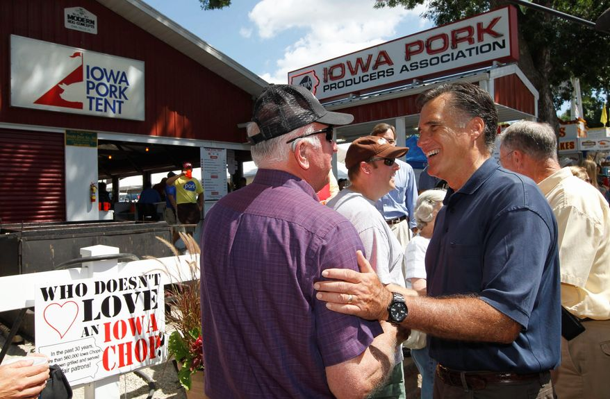 ASSOCIATED PRESS Mitt Romney campaigns at  the Iowa State Fair in Des Moines  on Thursday.  The former Massachusetts governor is  among the Republican candidates  in the state.