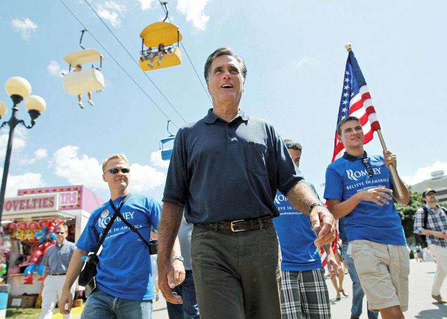 ASSOCIATED PRESS PHOTOGRAPHS DAY AT THE FAIR: Republican presidential candidate Mitt Romney makes the rounds at the Iowa State Fair in Des Moines on Thursday. Polls show the former Massachusetts governor is the front-runner for the 2012 GOP nomination.