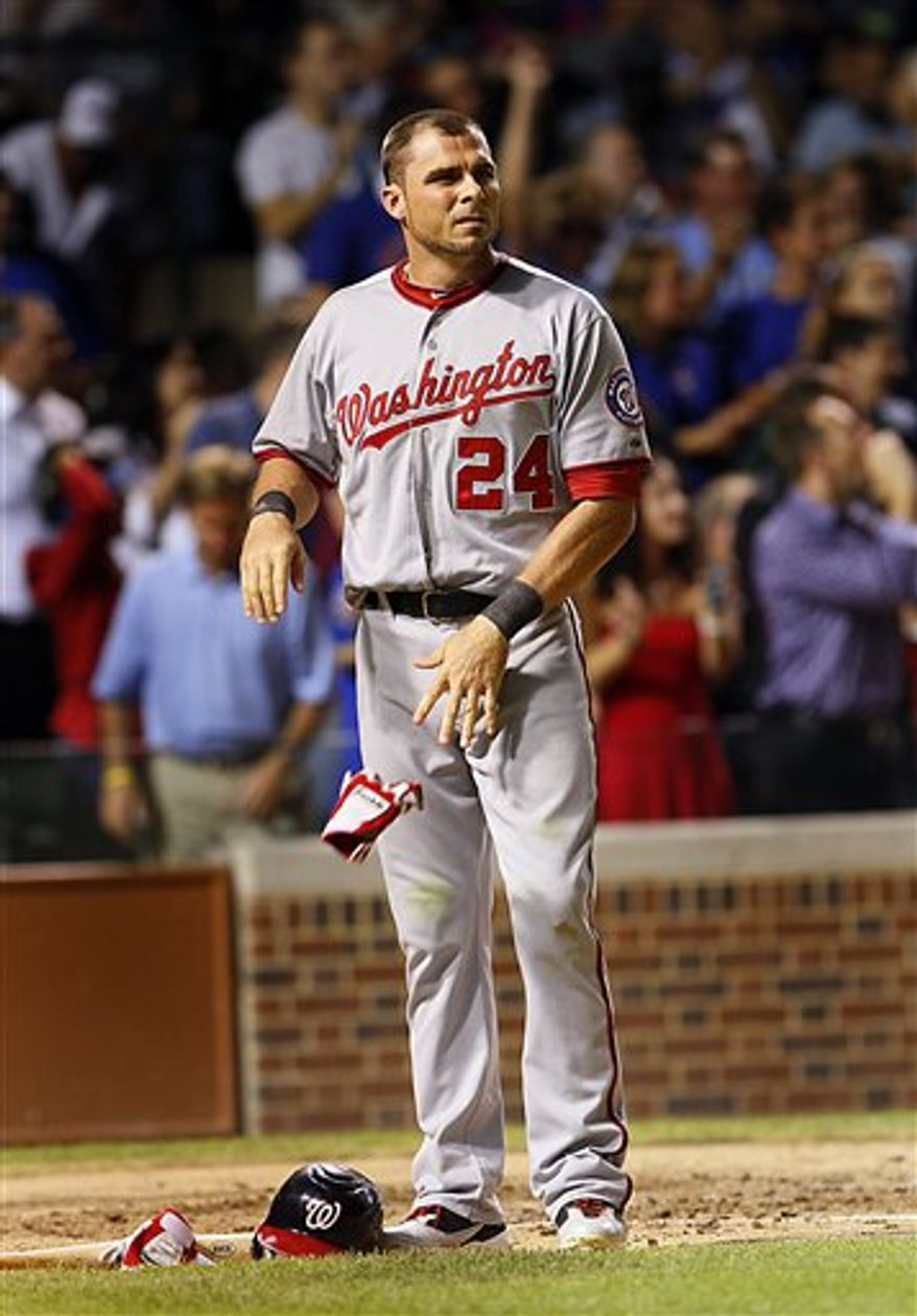 Washington Nationals' Rick Ankiel drops a batting glove after striking out to end the top of the seventh inning with a runner on third, against the Chicago Cubs in a baseball game Wednesday, Aug. 10, 2011, in Chicago. (AP Photo/Charles Cherney)