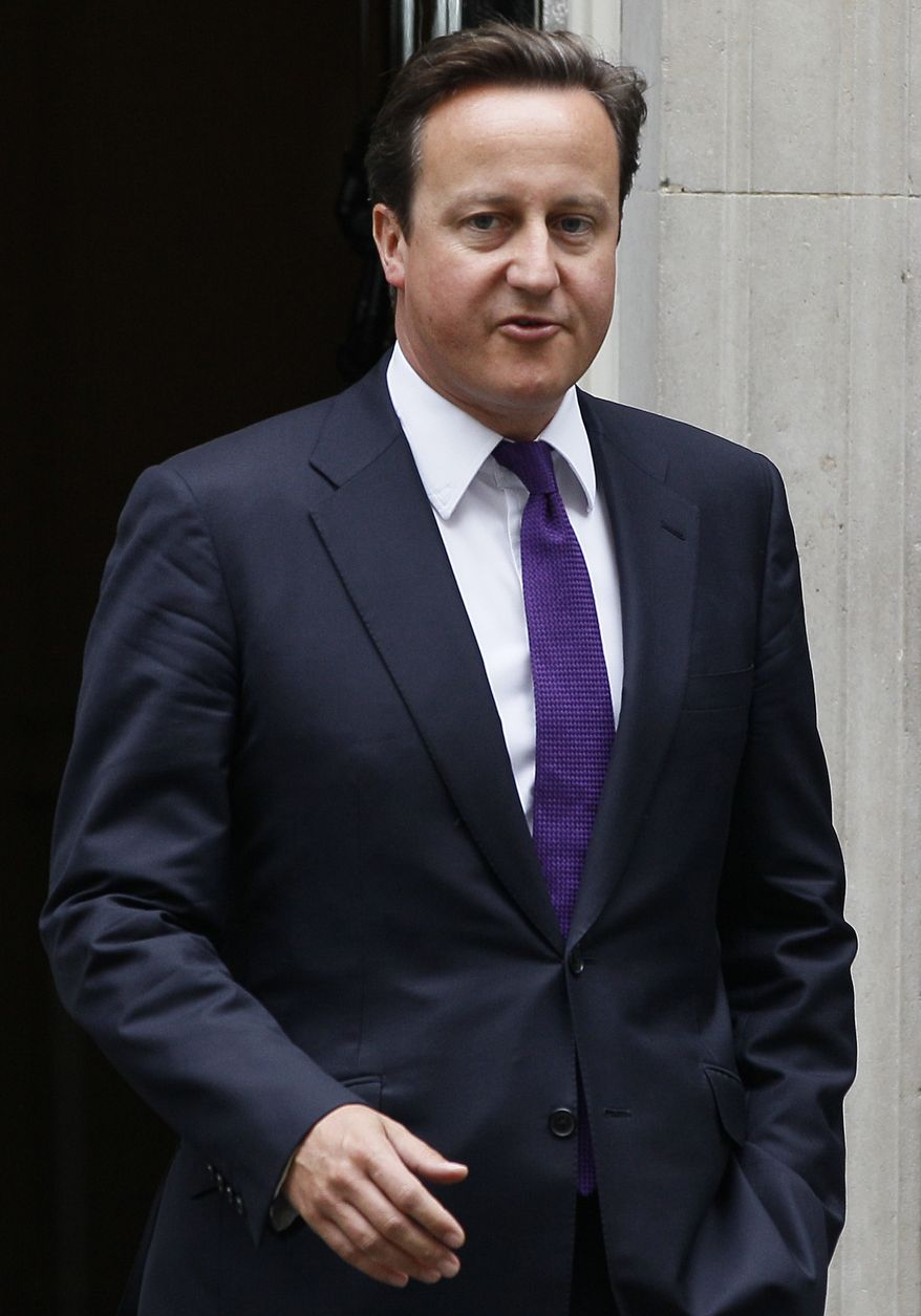 British Prime Minister David Cameron leaves 10 Downing St. in London on Thursday, Aug. 11, 2011, to attend an emergency session of Parliament to address recent rioting in the capital and other British cities. (AP Photo/Kirsty Wigglesworth)