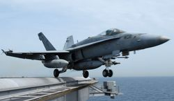 ** FILE ** An F/A-18C Hornet takes off from the Nimitz-class aircraft carrier USS John C. Stennis (CVN 74) in March 2007. (AP Photo/U.S. Navy, Paul J. Perkins, File)