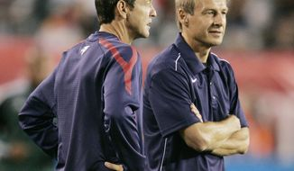 **FILE** U.S. men's soccer assistant coach Thomas Dooley and head coach Jurgen Klinsmann, look on from the sidelines during the warmups before a friendly between Mexico and the United States on Wednesday in Philadelphia. The U.S. tied Mexico, 1-1, after Robbie Rogers scored a late second-half goal. (AP Photo/Tom Mihalek)