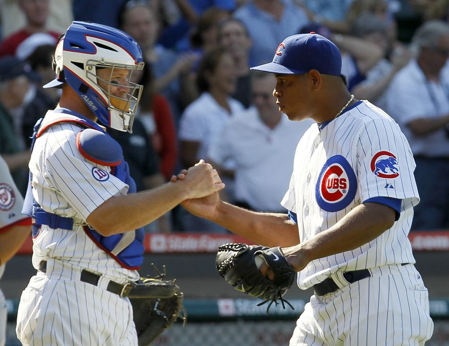 Chicago Cubs catcher Koyie Hill and closer Carlos Marmol celebrate their 4-3 win over the Washington Nationals  on Thursday. (AP Photo/Charles Rex Arbogast)
