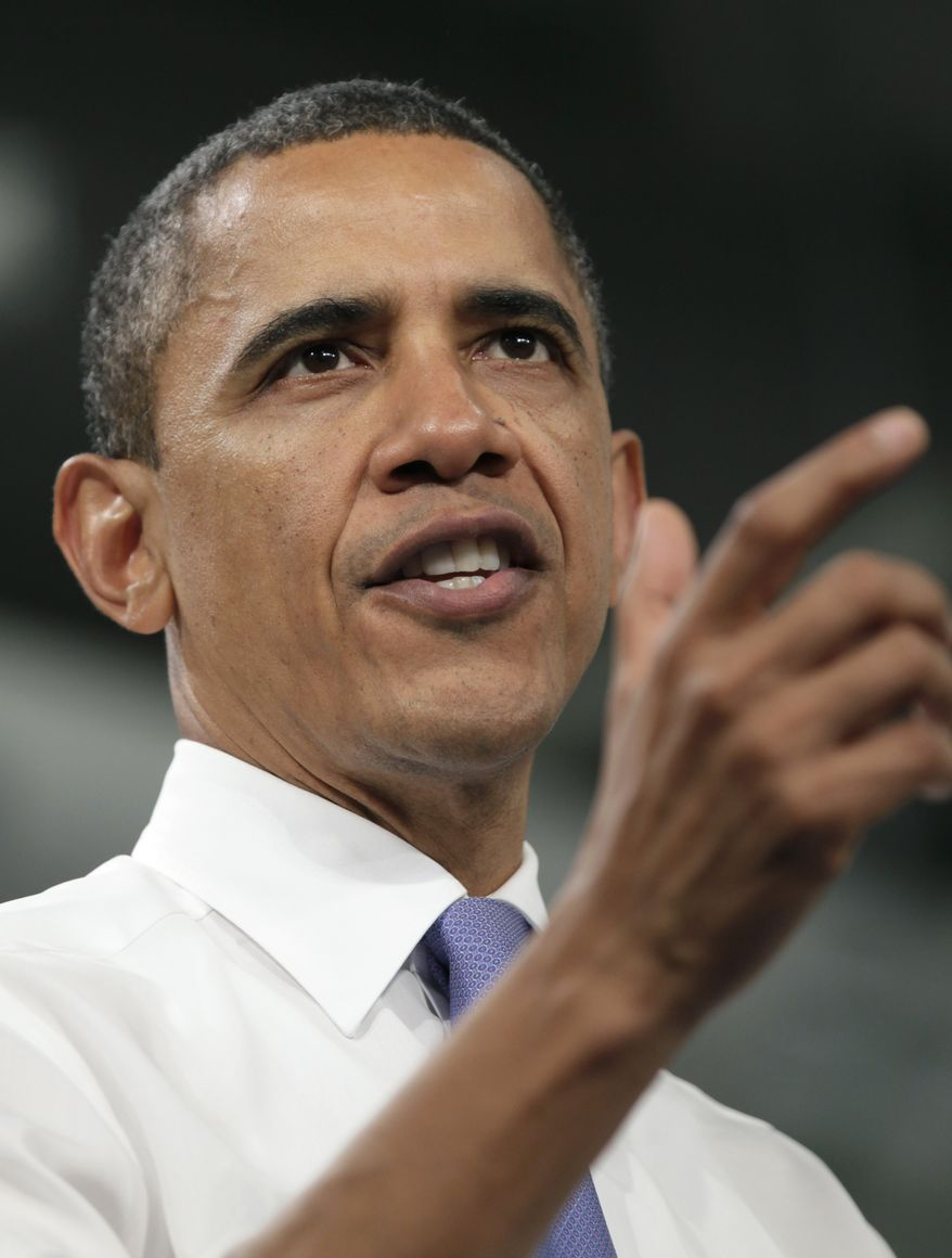 President Obama gestures while speaking about the role innovative technologies play in fuel economy standards and the economy on Aug. 11, 2011, at Johnson Controls Inc. in Holland, Mich. (Associated Press)
