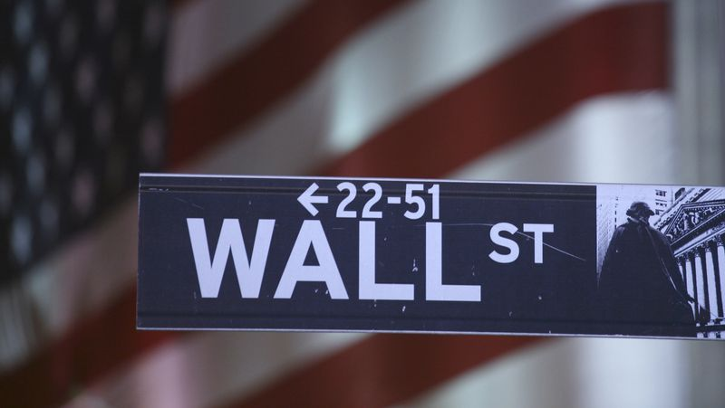 **FILE** A sign marks Wall Street in New York. (Associated Press)