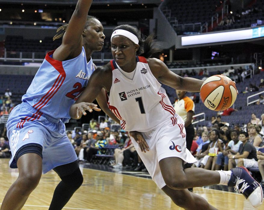 Washington Mystics' Crystal Langhorne (shown in a photo against the Atlanta Dream) led the Mystics in scoring with 18 points in their 64-63 win against the New York Liberty on Friday night. (AP Photo/Manuel Balce Ceneta)