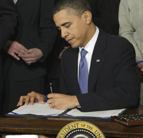 President Obama signs the health care bill in the White House on March 23, 2010. (Associated Press) **FILE**