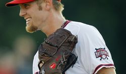 As he rehabs from Tommy John surgery, Washington Nationals' Stephen Strasburg is scheduled to start Wednesday, with another Hagerstown appearance likely. (AP Photo/Luis M. Alvarez)