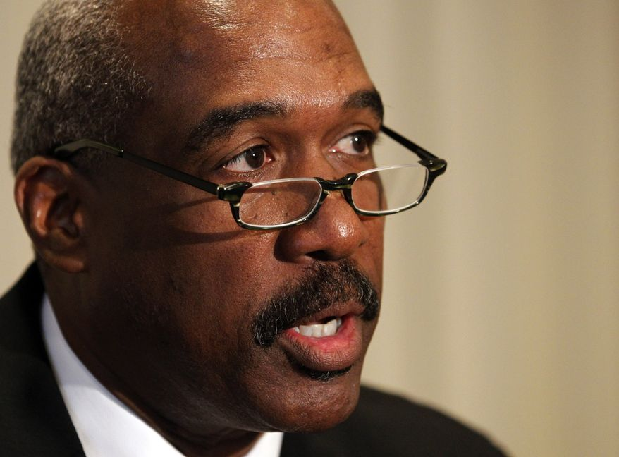 Ohio State athletic director Gene Smith makes a statement following a hearing by an NCAA infractions committee in Indianapolis, Ind. on Friday, Aug. 12, 2011. (AP Photo/Michael Conroy)