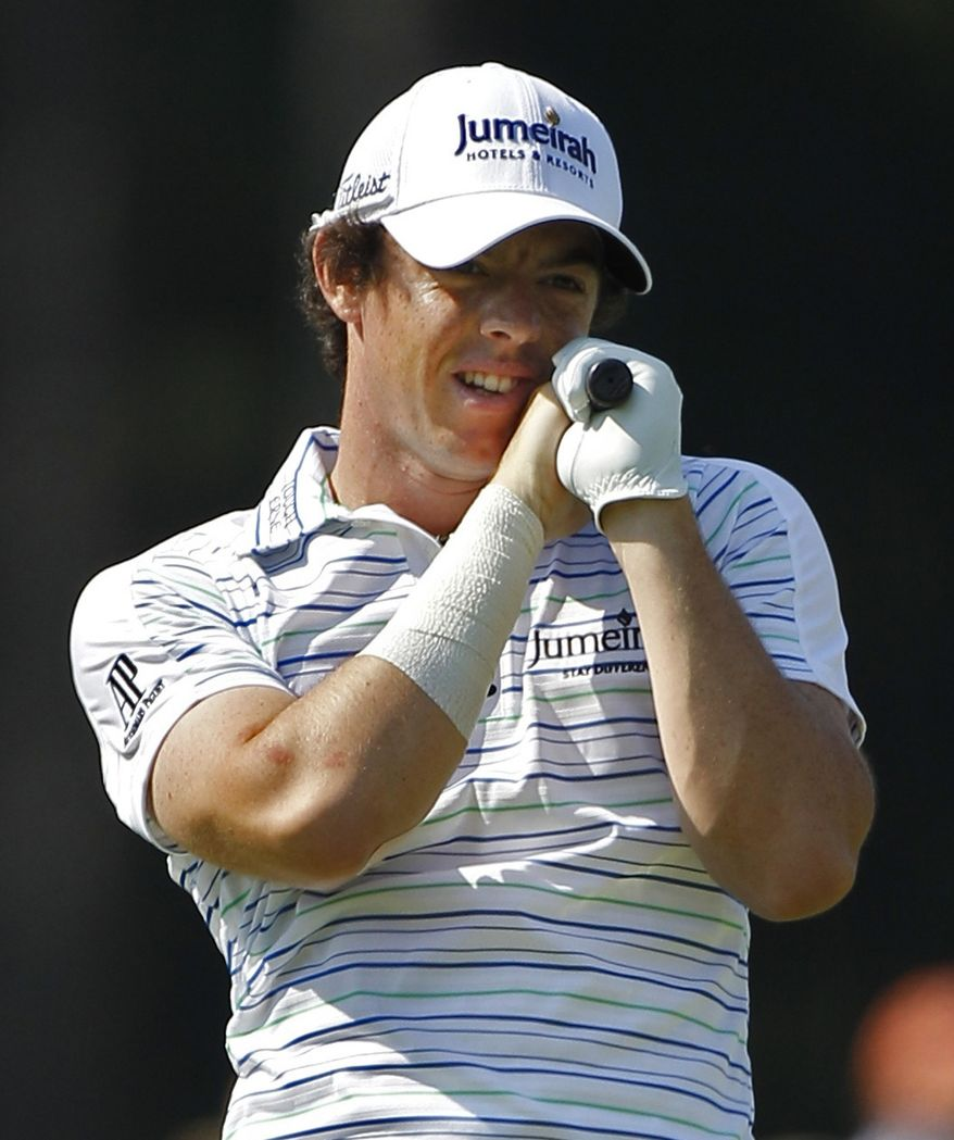 Rory McIlroy, of Northern Ireland, reacts to his tee shot on the 18th hole during the second round of the PGA Championship golf tournament Friday, Aug. 12, 2011, at the Atlanta Athletic Club in Johns Creek, Ga. (AP Photo/Matt Slocum)