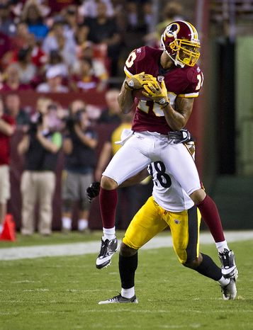 Jabar Gaffney of the Washington Redskins (10) puls down a pass against Crezdon Butler (28) of the Pittsburg Steelers defense at FedEx Field in Landover, Md, Friday, August 12, 2011. (Rod Lamkey Jr./The Washington Times)