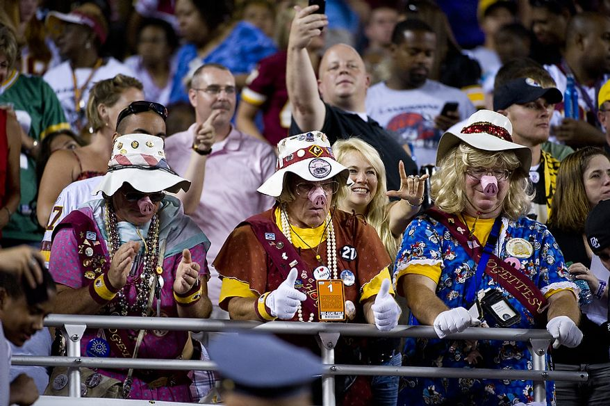 Members of the Hogettes cheers on their Washington Redskins as they leave the field at half time at FedEx Field in Landover, Md, Friday, August 12, 2011. (Rod Lamkey Jr./The Washington Times)