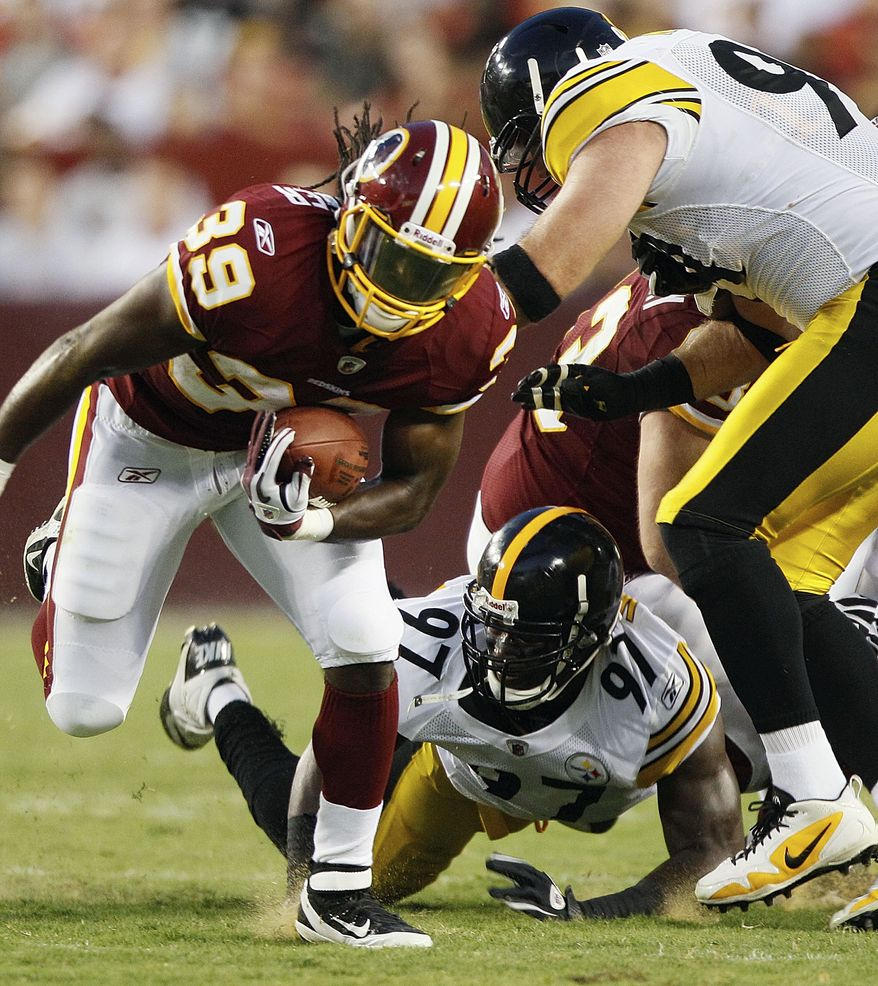 Washington Redskins running back Tim Hightower breaks free from Pittsburgh Steelers linebacker Jason Worilds (97) and Steelers defensive end Brett Keisel during the first half of an NFL preseason football game in Landover, Md., on Friday, Aug. 12, 2011. (AP Photo/Patrick Semansky)