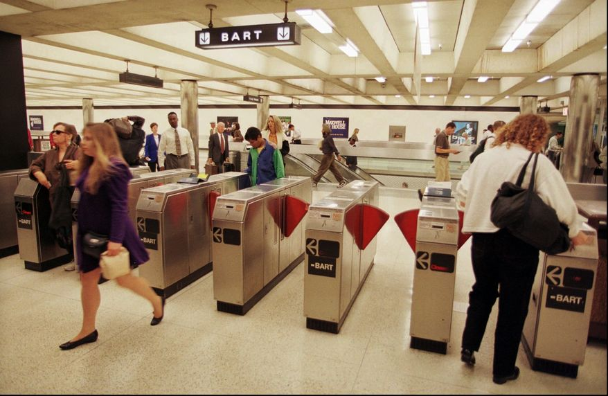 ** FILE ** Commuters enter and exit a Bay Area Rapid Transit (better known as BART) station in San Francisco's financial district in this Sept. 15, 1997, file photo. (AP Photo/Robin Weiner, File)