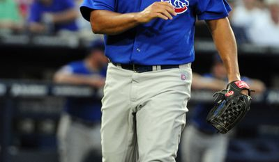 """Chicago Cubs starting pitcher Carlos Zambrano allowed a career-worst five homers against the Atlanta Braves on Friday, and manager Mike Quade said he then left the team. Quade said, """"His locker is empty. He walked out on 24 guys ... I don't know where he's gone or what he's doing."""" Saturday, the Cubs placed him on the disqualified list. (AP Photo/Dave Tulis)"""