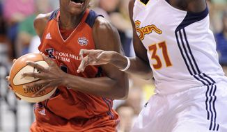 Despite battling foul trouble, Washington Mystics' Crystal Langhorne scored a game-high 17 points in the Mystics' 82-75 loss against the Connecticut Sun. (AP Photo/Fred Beckham)