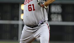 Washington Nationals starting pitcher Livan Hernandez threw 6 2/3 innings and allowed just one unearned run in the Nats' 4-2 win over the Philadelphia Phillies on Friday. (AP Photo/Alex Brandon)