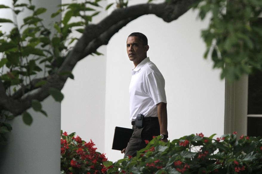 ** FILE ** President Barack Obama leaves the Oval Office of the White House in Washington Saturday, Aug. 13, 2011, on his way to play golf at Andrews Air Force Base. (AP Photo/Jacquelyn Martin)