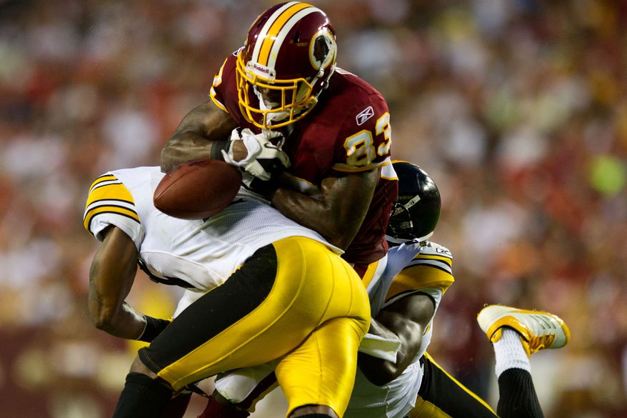 Redskins tight end Fred Davis (83) can't hang on to a pass as he is hit by two Steeler defenders, during a preseason game between the Washington Redskins and the Pittsburgh Steelers, at FedEx Field in Landover, Md., Friday, Aug. 12, 2011. (Drew Angerer/The Washington Times)