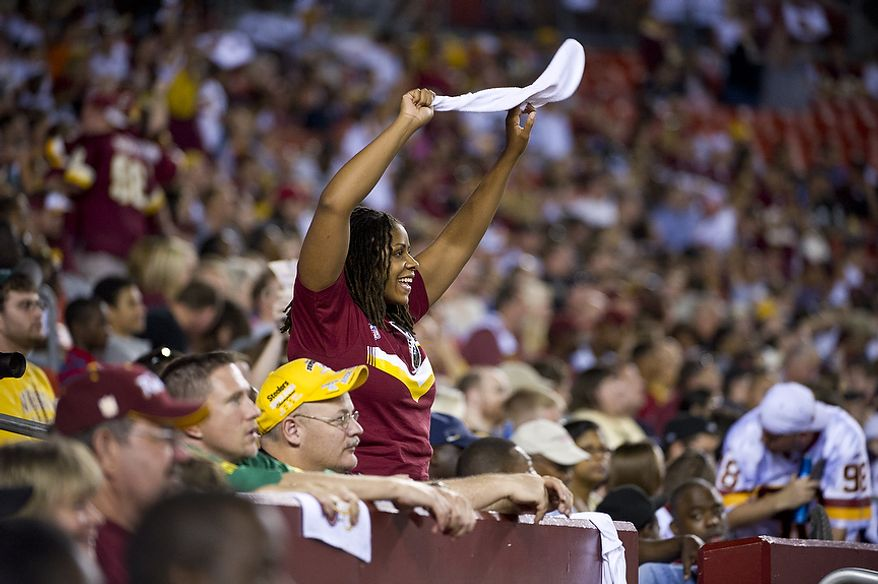 A Washington Redskins fan cheers from the stands as the Redskins play the Pittsburg Steelers at FedEx Field in Landover, Md, Friday, August 12, 2011. (Rod Lamkey Jr./The Washington Times)