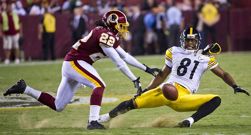 Kevin Barnes (22) of the Washington Redskins breaks up a pass intended for Arnaz Battle (81) of the Pittsburg Steelers in the fourth quarter at FedEx Field in Landover, Md, Friday, August 12, 2011. (Rod Lamkey Jr./The Washington Times)