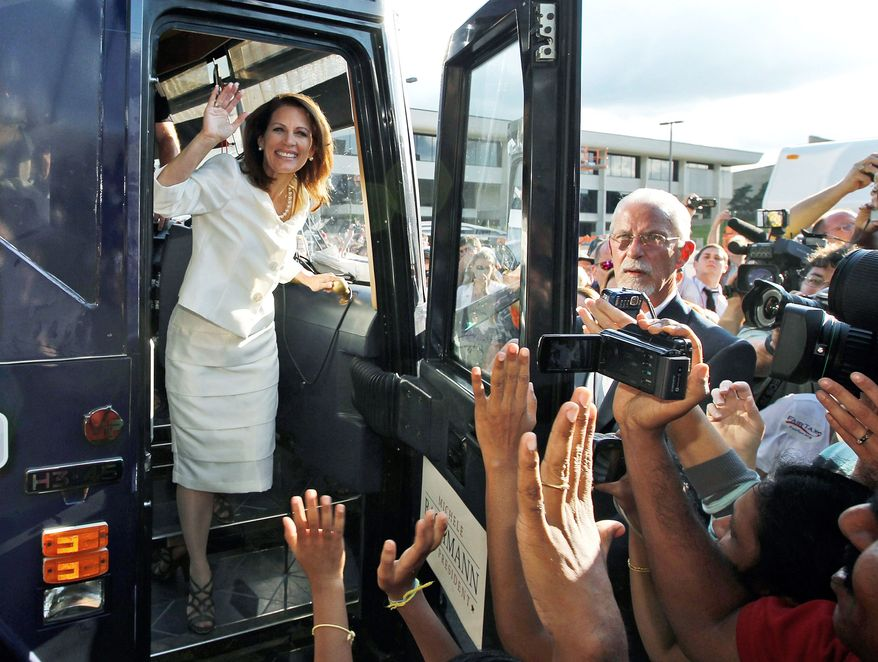 HOMETOWN HERO: Republican presidential candidate Rep. Michele Bachmann steps from her campaign bus to greet supporters after winning the Iowa Republican Party's straw poll on Saturday. (Associated Press)