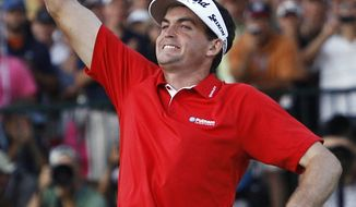 Keegan Bradley celebrates on the 18th green after winning a three-hole playoff against Jason Dufner at the PGA Championship golf tournament Sunday, Aug. 14, 2011, at the Atlanta Athletic Club in Johns Creek, Ga. (AP Photo/Matt Slocum)