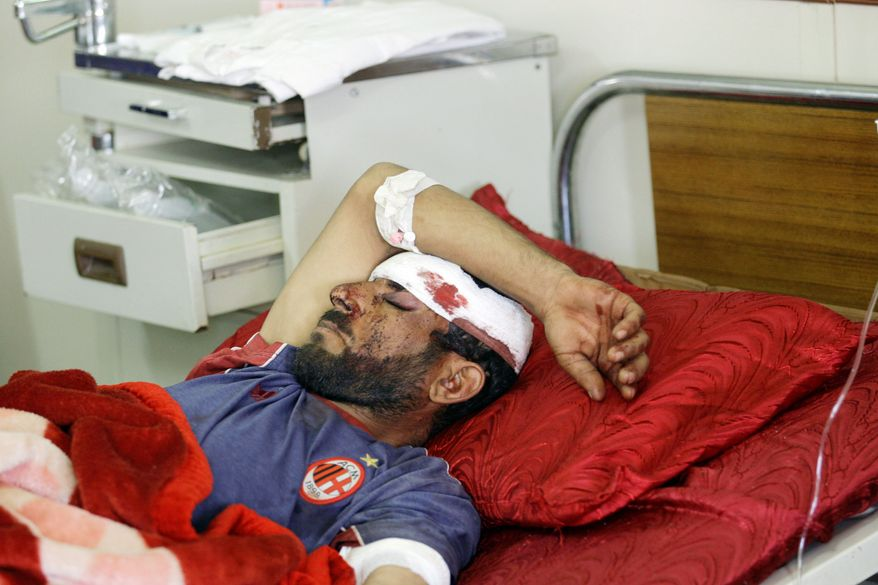 ASSOCIATED PRESS PHOTOGRAPHS Samir Yousif, 31, is treated at a hospital in Kut, Iraq, after a car bomb exploded on Monday.