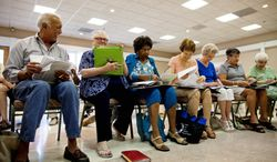 Phil Soriano is outnumbered by women during choir practice at Leisure World retirement community north of Silver Spring, where two-thirds of the residents are women. Among Langley Park's recent immigrants from South America, women are a small minority. (Pratik Shah/The Washington Times)