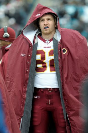 Washington Redskins tight end Logan Paulsen (82) keeps warm on the sideline during an NFL football game against the Jacksonville Jaguars in Jacksonville, Fla., Sunday, Dec. 26, 2010.(AP Photo/Phelan M. Ebenhack)