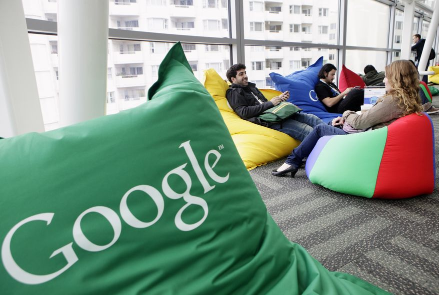**FILE** Attendees chat May 11, 2011, at the Google IO Developers Conference in San Francisco. (Associated Press)