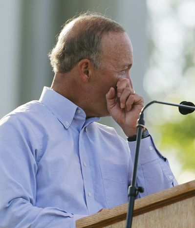 Indiana Gov. Mitch Daniels wipes a tear during a memorial service for the five people who were killed when a stage collapsed Saturday at the Indiana State Fair. (AP Photo/Darron Cummings)