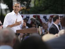 President Obama speaks during a town hall meeting at Lower Hannah's Bend Park in Cannon Falls, Minn., on Aug. 15, 2011. (Associated Press)