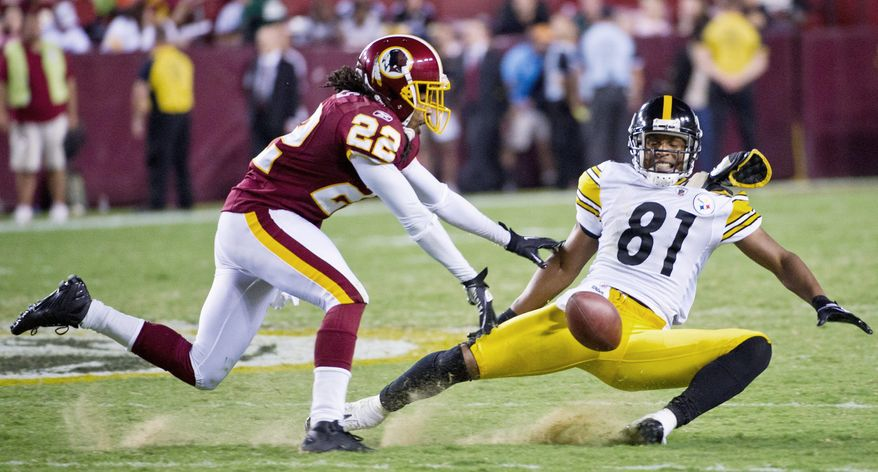Cornerback Kevin Barnes was a presence in the Redskins' preseason opener Friday, breaking up a pass intended for Pittsburgh wide receiver Arnaz Battle (top) and taking down quarterback Ben Roethlsberger in the backfield. (Rod Lamkey Jr./The Washington Times)