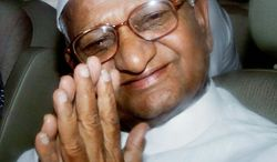Anna Hazare gestures to supporters from the back of a police van after he was detained prior to beginning a hunger strike on Tuesday.