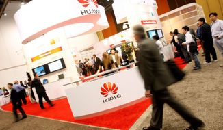 Huawei made its presence at a wireless trade show in Las Vegas this year. Some in Congress fear the Chinese telecommunications giant, said to have ties to China's military, poses a risk to national security with its deal to supply components to a supercomputer lab that is a defense contractor. (Associated Press)