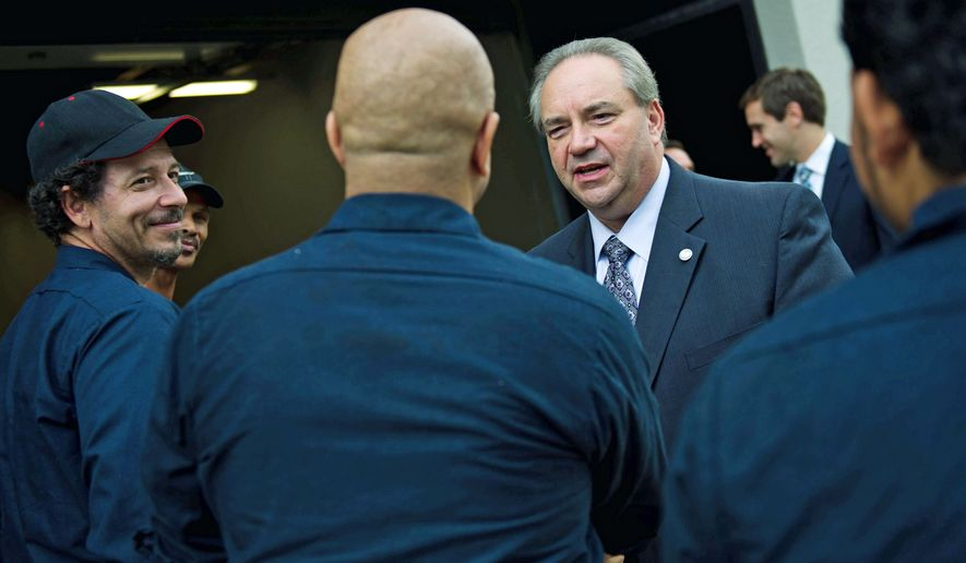 Virginia Lt. Gov. Bill Bolling greets employees of Hadpro - Hood and Duct Professionals - at Tuesday's ribbon cutting for the company's new headquarters in Alexandria. Mr. Bolling will serve at Mitt Romney's Virginia campaign director. (Drew Angerer / The Washington Times)