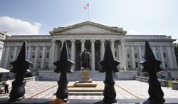 A statue of former Treasury Secretary Albert Gallatin stands guard outside the Treasury Building in Washington.