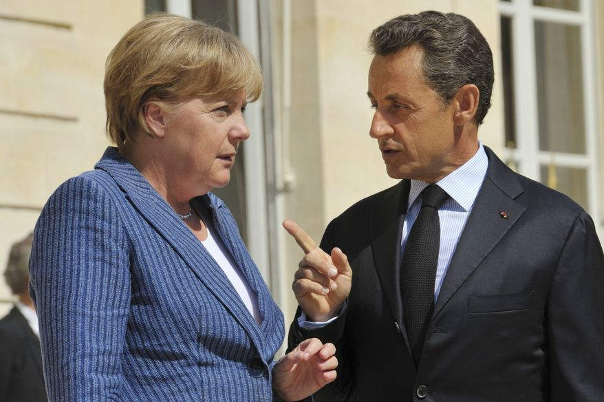 French President Nicolas Sarkozy welcomes German Chancellor Angela Merkel to the Elysee Palace in Paris on Tuesday, Aug. 16, 2011, for talks on the eurozone's economic problems. (AP Photo/Philippe Wojazer, Pool)