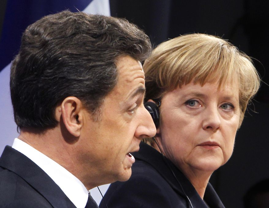 ** FILE ** French President Nicolas Sarkozy and German Chancellor Angela Merkel speak at a press conference during German-French consultations in Freiburg, Germany, in December 2010. (AP Photo/Michael Probst, File)