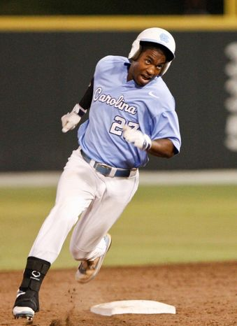 North Carolina's Brian Goodwin runs to third in the bottom of the ninth inning of Game 4 of an NCAA college baseball regional game in Norman, Okla., on Saturday, June 5, 2010. (AP Photo/Alonzo Adams)