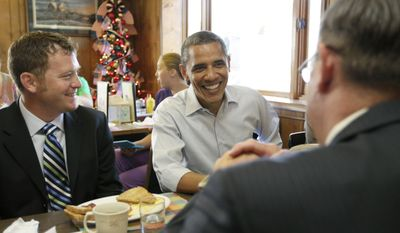 President Obama stops for breakfast on Aug. 16, 2011, with small business owners at Rausch's Cafe in Guttenberg, Iowa, during his three-day bus tour devoted to the economy. (Associated Press)