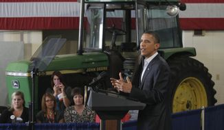 President Obama speaks during a Rural Economic Forum on Aug. 16, 2011, at Northeast Iowa Community College in Peosta, Iowa, during his three-day bus tour devoted to the economy. (Associated Press)