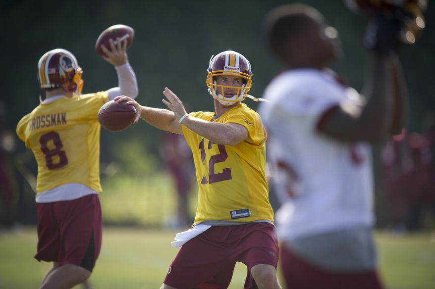Washington Redskins quarterbacks Rex Grossman, left, and John Beck, center, work on pass drills during practice Tuesday. (Rod Lamkey Jr./The Washington Times)