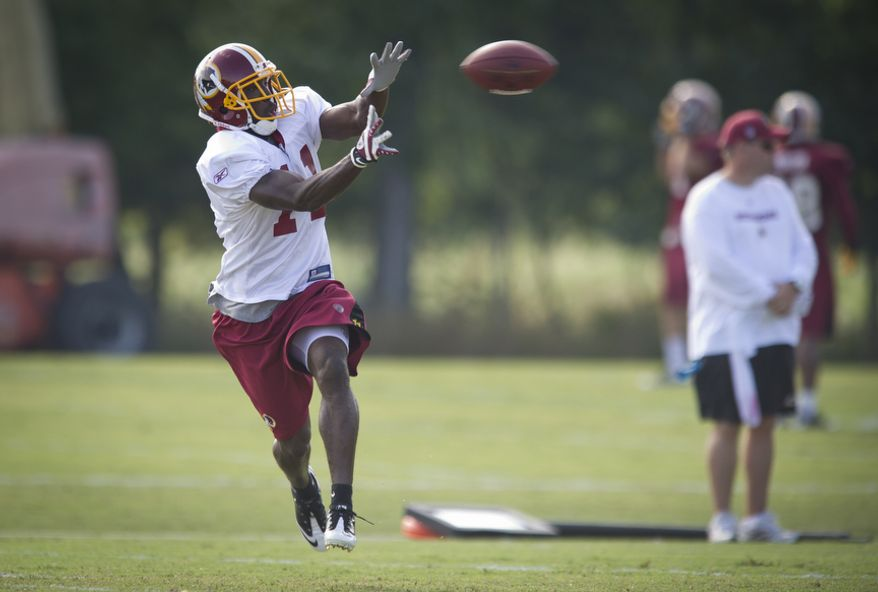 Washington Redskins wide receiver Aldrick Robinson reaches out to catch the ball during practice Tuesday. (Rod Lamkey Jr./The Washington Times)