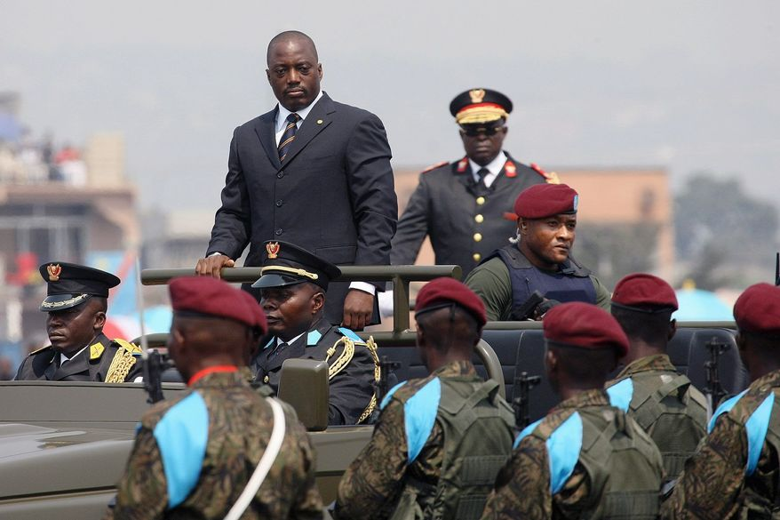 ASSOCIATED PRESS PHOTOGRAPHS President Joseph Kabila (far left) arrives for the yearly national parade held in Kinshasa. He has held office for more than 10 years and recently secured constitutional changes that strengthen his powers and revise the country's voting system. He faces a possible challenge at the polls this November from Jean-Pierre Bemba, Vital Kamerhe and Etienne Tshisekedi (starting second photo, left). Mr. Bemba is awaiting a war crimes trial at the International Criminal Court at The Hague.       United Nations Secretary-General Ban Ki-moon, left, and National Assembly President Vital Kamerhe, right, shake hands in Kinshasa, Congo, Saturday, Jan. 27, 2007. Ki-moon held up Congo's first elections in 46 years as a sign of hope for the rest of war-torn Africa, praising the country's fragile democracy Saturday. (AP Photo/John Bompeng)    Veteran opposition leader Etienne Tshisekedi is seen at his residence in Kinshasa, Congo in this Thursday, June 15, 2006 photo. A former prime minister under the Mobutu regime, he remains an influential figure and his support could boost any of Congo's presidential hopefuls. (AP Photo)